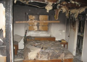 Fire damage to a bedroom.
