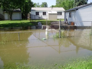 flood damage repair, flooded yard, restoration company,