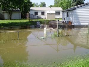 flood damage repair, flooded yard, restoration company,