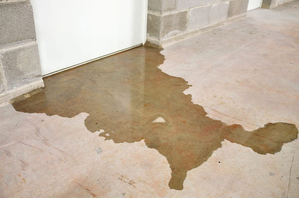 Basement Water Damage: Flood water from a hot water tank malfunction.