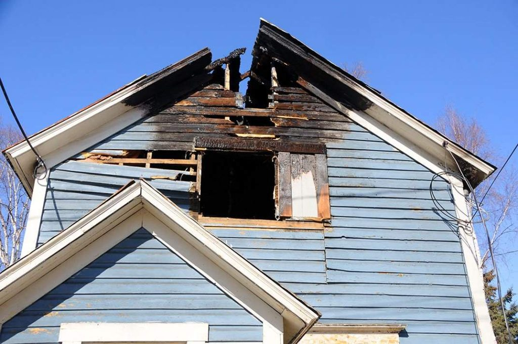 fire damaged home in Haukanier, TX