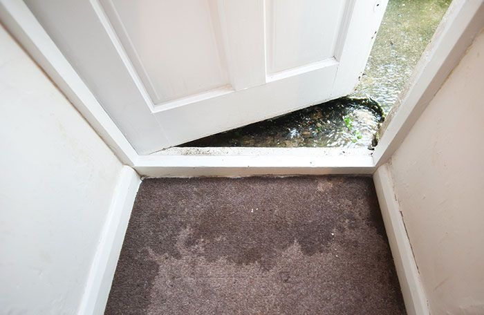 Image of flooded doorway from water damage