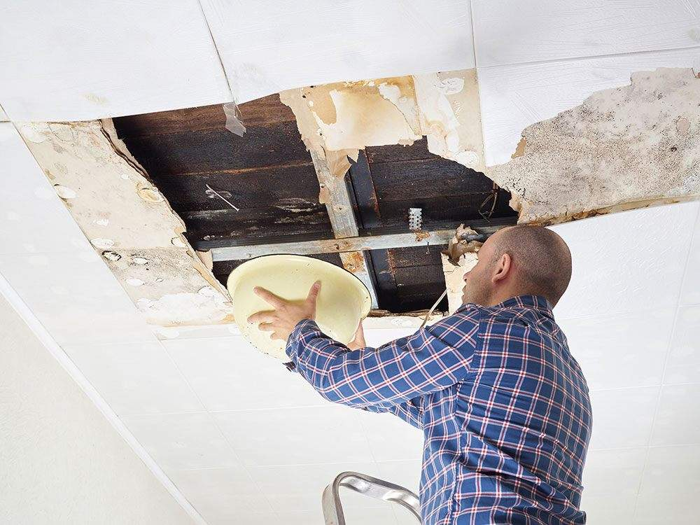 man repairing water damage in Panther Forest, AR