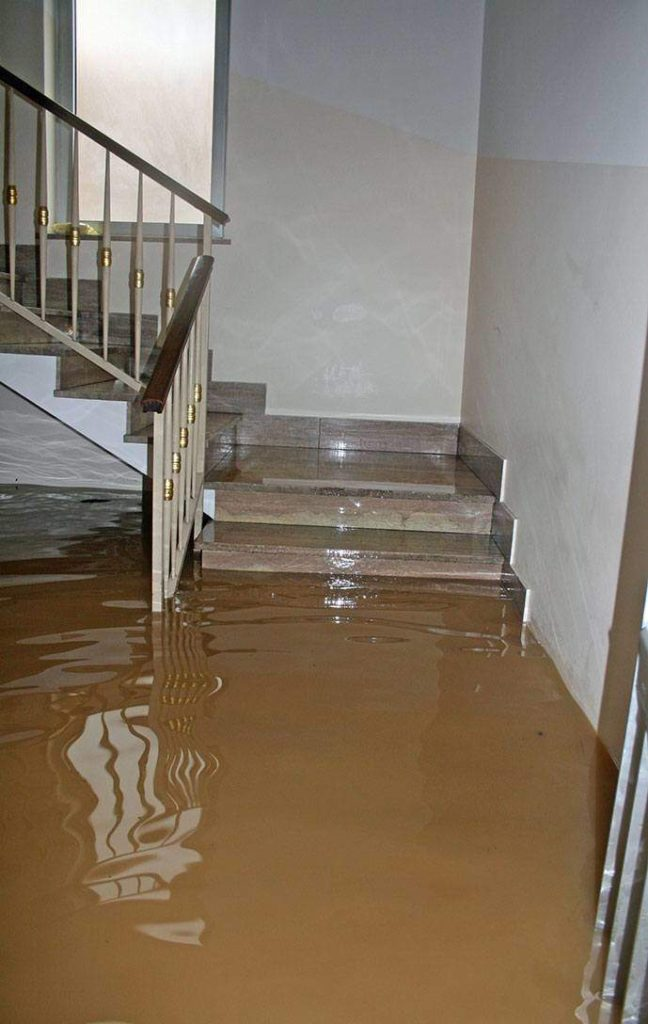stairs with water damage in Haukanier, TX